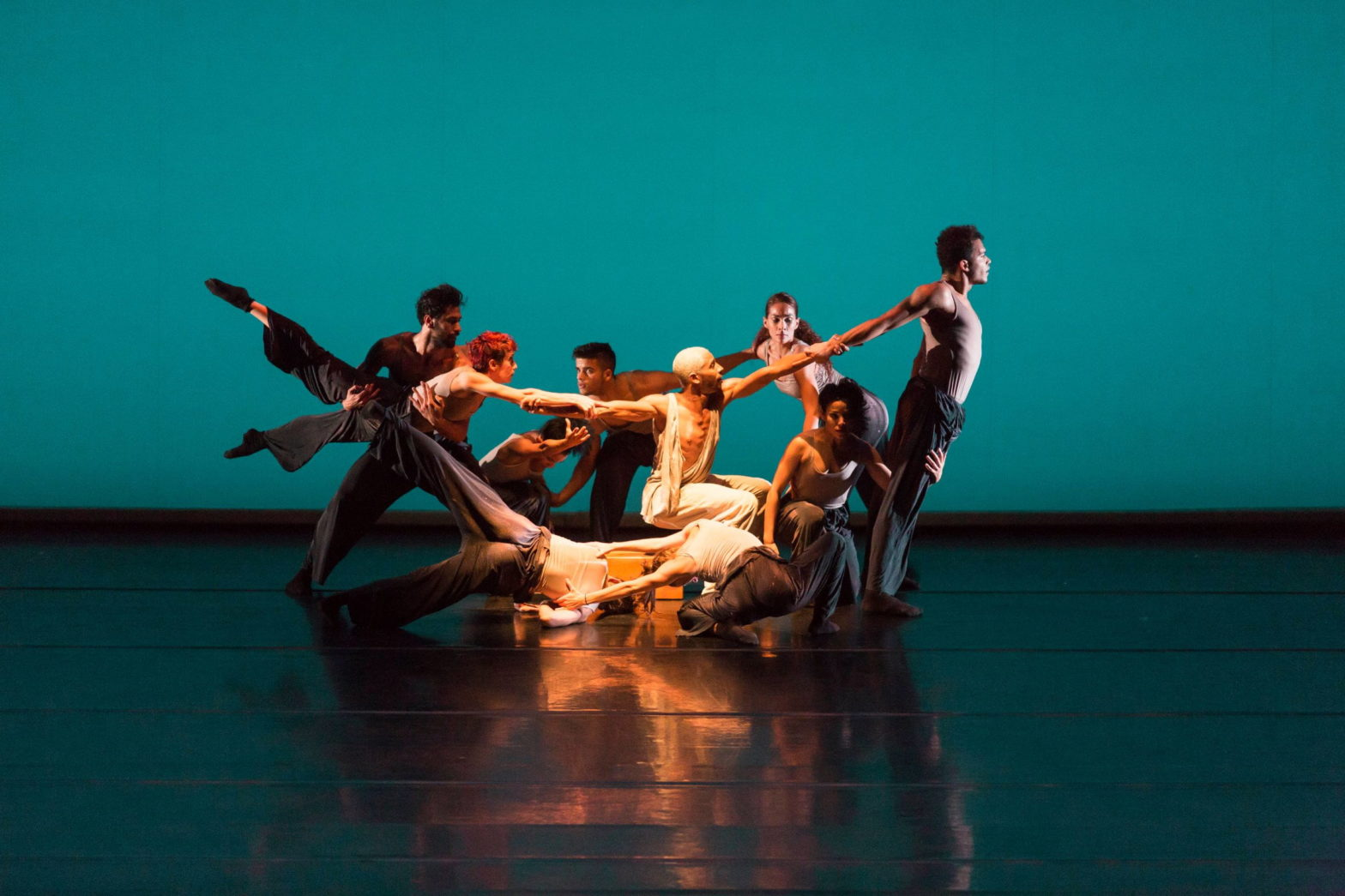 A group of dance artists on stage. The image highlights the work of artists in a blog post about how to support the arts.