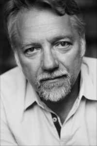 Black and white head shot photo of Edward Burtynsky