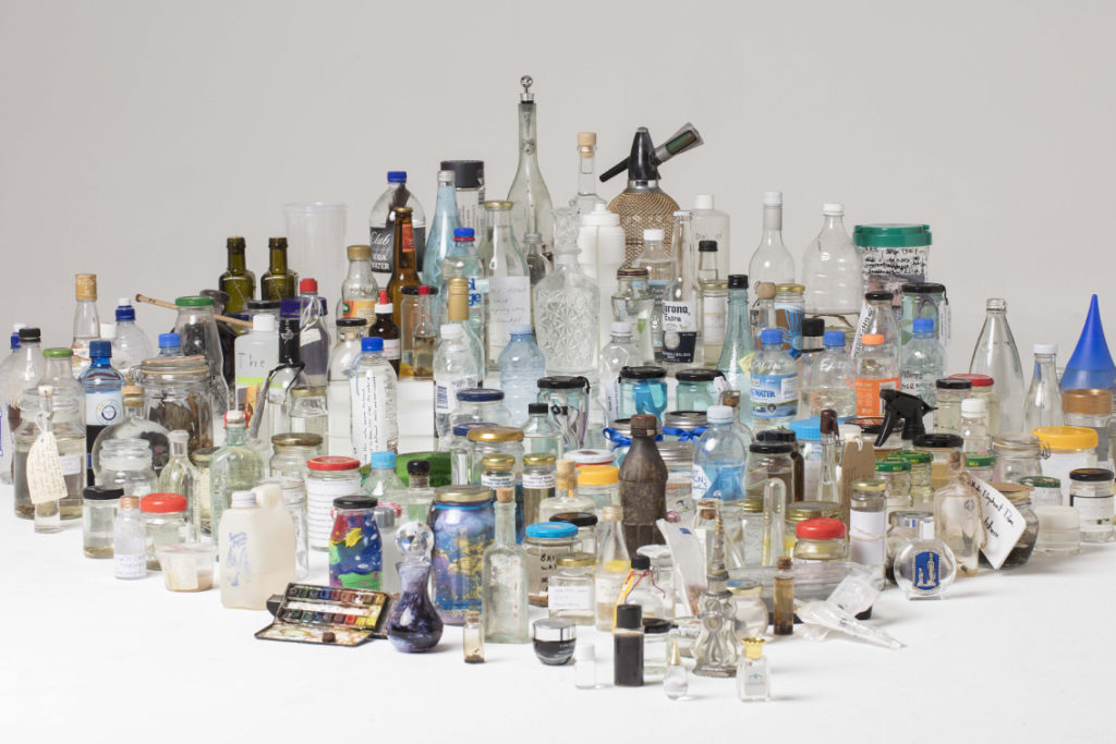 Collection of bottles containing water. Luminato 2021.