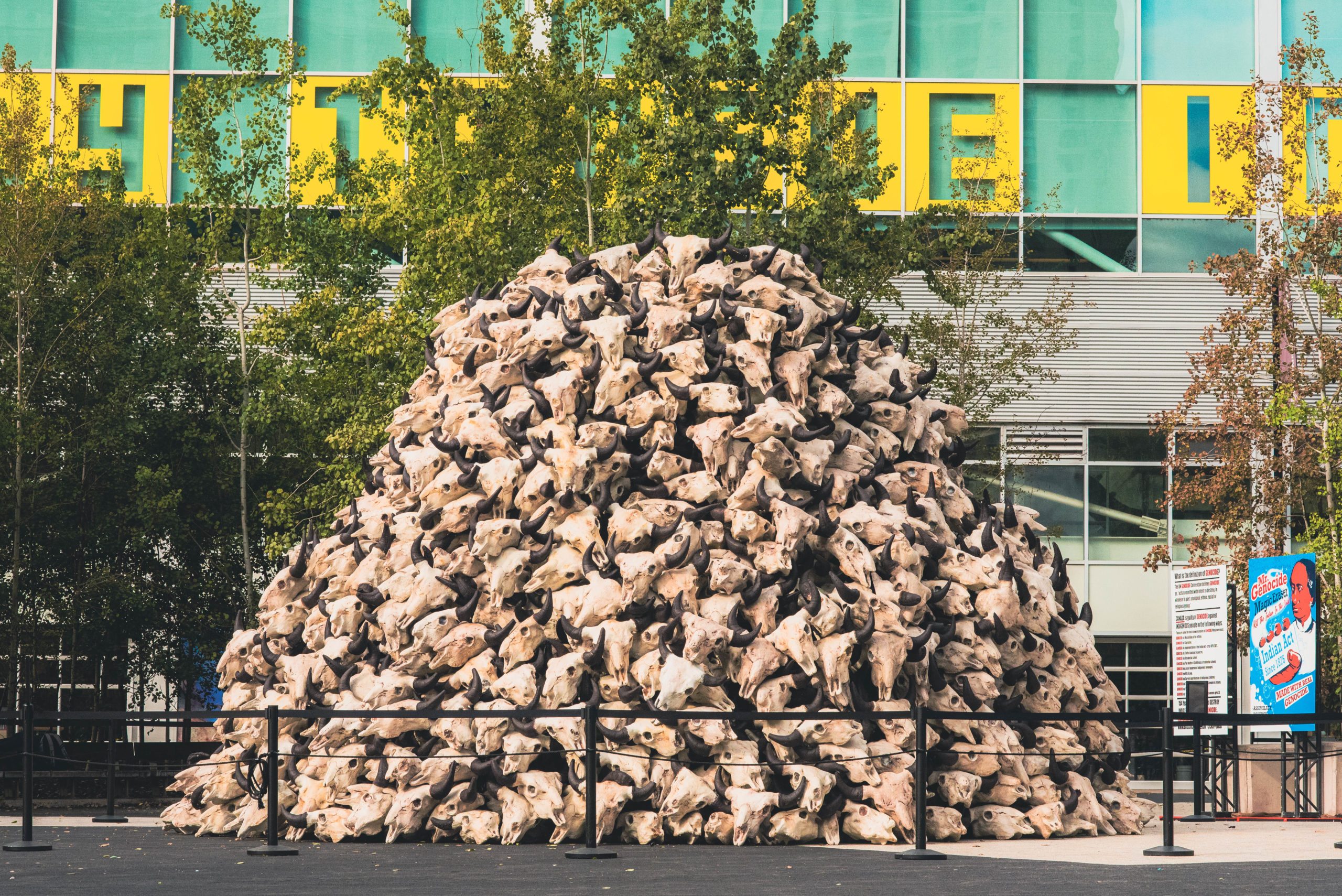 A photo of Jay Soule | CHIPPEWAR's art installation depicting a mound of buffalo skulls at Harbourfront Centre.