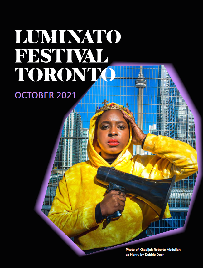 Cover of the Luminato brochure. Background is black with an asymetrical shape with a purple glow. Inside the shape is Khadijah Roberts-Abdullah as Henry from Henry g20. She's wearing a crown and holding a megaphone.