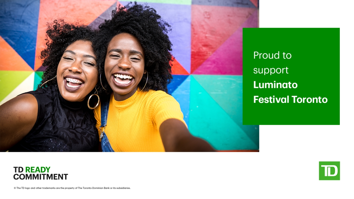 TD Ready Commitment - Luminato Supporter. Image of two women of colour smiling at the camera with a colourful background.