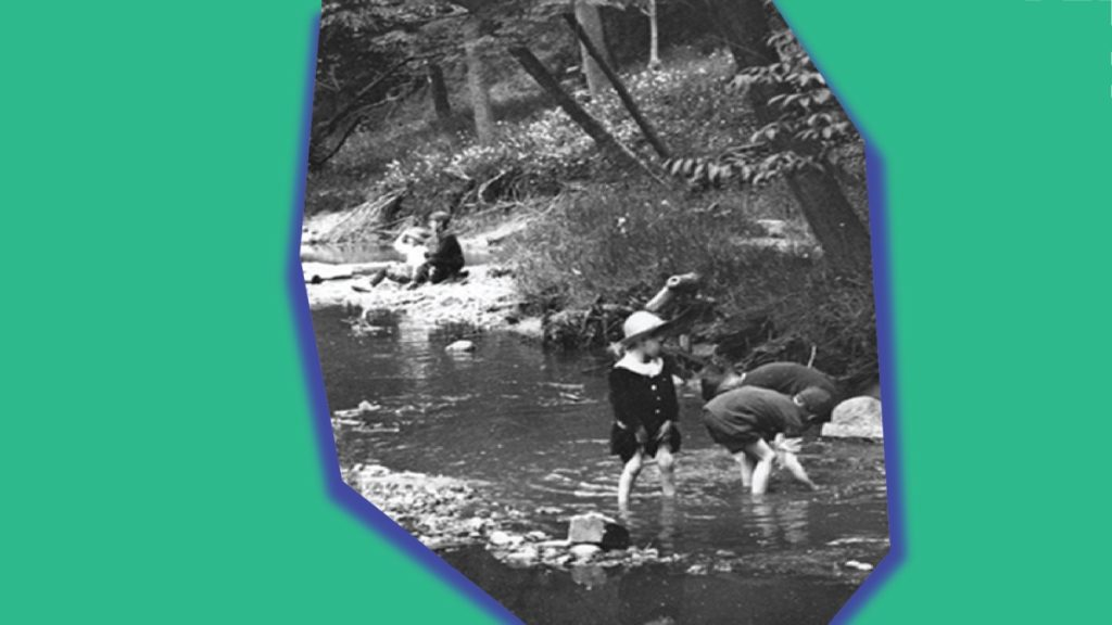 Green background with asymetrical shape in the centre. The shape holds a black and white image of children playing in a creek.
