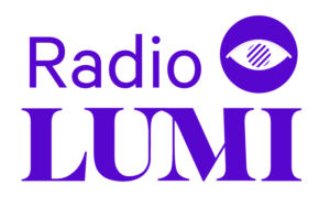 Image of Radio Lumi Logo. The words Radio Lumi appears in purple text in bold font. Partially sighted access symbol is located on the right top corner next to the text Radio.