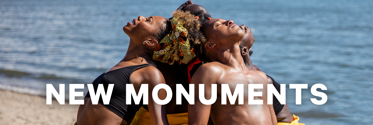 Image for New Monuments features four black dancers wearing yellow jumpsuits back to back and holding hands.