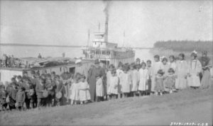 Banner image. Aboriginal children at the Roman Catholic-run Fort Providence Indian Residential Mission School