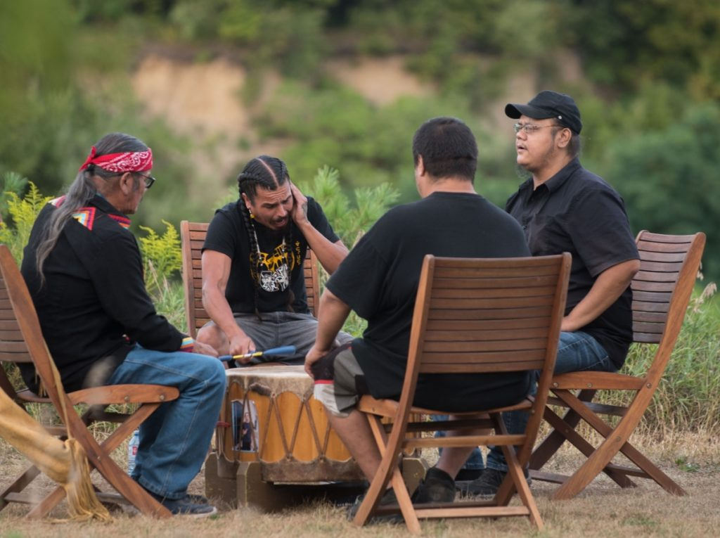 Image of Eagleheart Drummers & Singers playing the drum